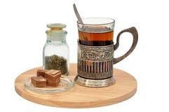 Juego de té con el vidrio-tenedor aislado Imagenes de archivo