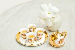 Juego de té del chino del oro Fotografía de archivo libre de regalías