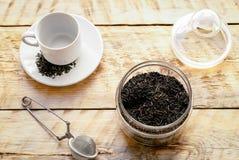 Juego de té en la tabla de madera Foto de archivo