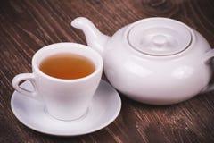 Juego de té negro con la taza Fotografía de archivo