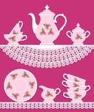 Juego de té rosado con las rosas Fotos de archivo libres de regalías