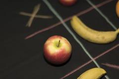 Juego de Tris con la fruta Foto de archivo libre de regalías