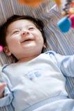 Juego del bebé con los juguetes Fotos de archivo