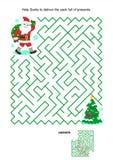 Juego del laberinto para los niños - Papá Noel entrega los presentes Foto de archivo libre de regalías
