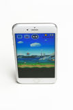 Juego estupendo de Mario Run en iPhone imágenes de archivo libres de regalías