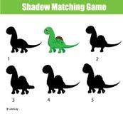 Juego a juego de la sombra Juego educativo de los niños con el carácter de Dino Foto de archivo libre de regalías
