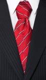Juego y corbata roja Fotografía de archivo