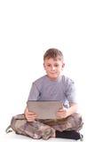 Juegos adolescentes en el ordenador de la tablilla Fotografía de archivo libre de regalías