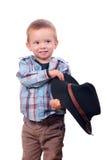 Juegos bonitos del niño pequeño con el sombrero de vaquero Foto de archivo