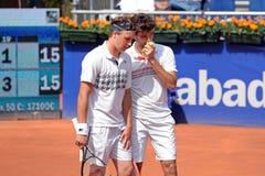 Juegos de Draganja (derecho) y de Kontinen (dejado) en el ATP Barcelona Fotos de archivo