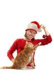 Juegos de la muchacha con un gato Imágenes de archivo libres de regalías