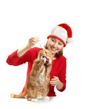 Juegos de la muchacha con un gato Fotografía de archivo