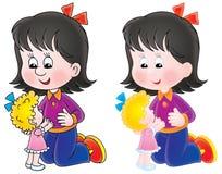 Juegos de la muchacha con una muñeca Foto de archivo libre de regalías