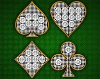 Juegos de la tarjeta sobre fondo textured verde Imagenes de archivo