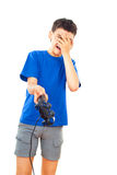 Juegos del muchacho con una palanca de mando Foto de archivo libre de regalías