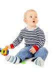 Juegos del niño con los juguetes Imagen de archivo