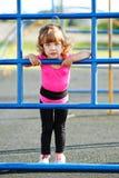 Juegos lindos de la niña en patio Imagen de archivo libre de regalías