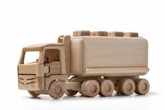 Juegue, camión de madera con el tanque, aislado en el fondo blanco Fotos de archivo libres de regalías