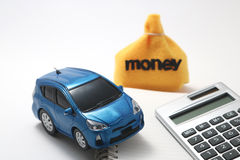 Juegue el coche, el dinero, la calculadora, y el cuaderno Imagen de archivo libre de regalías