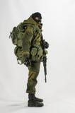 Juegue la figura de acción del soldado de la escala del hombre 1/6 fondo blanco realista miniatura del ejército Imágenes de archivo libres de regalías