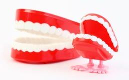 Juegue la quijada con los dientes y la quijada que traga el mecanismo Foto de archivo libre de regalías