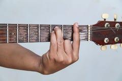 Juegue la versión 3 de la guitarra a mano imagen de archivo