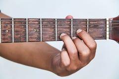 Juegue la versión 4 de la guitarra a mano fotos de archivo