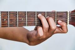 Juegue la versión 6 de la guitarra a mano fotos de archivo libres de regalías