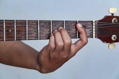 Juegue la versión 20 de la guitarra a mano imagen de archivo