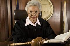 Juez Sitting With Book Fotografía de archivo libre de regalías