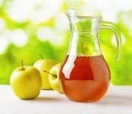 Jug of apple juice Stock Photo