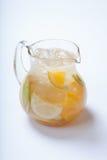 A jug of apple lemonade , apple and lemon and ice Stock Image