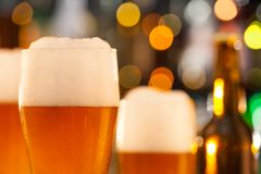 Jug of beer served on bar counter Royalty Free Stock Photography