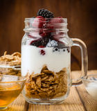 Jug with berries cerealas  and yogurt Stock Photography