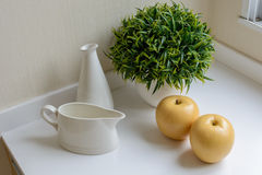 A jug with bottle, apple and decorativ Stock Photography