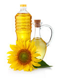 Jug and bottle of sunflower oil with flowe royalty free stock photo