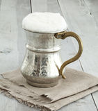 Jug of butttermilk on wooden table Royalty Free Stock Image