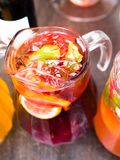 Jug with juice and pieces of fruit royalty free stock photo