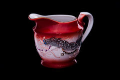 Jug of chinese dinner service on black background Stock Image