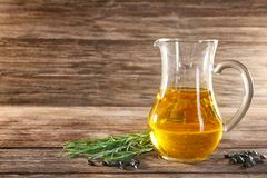 Jug with cooking oil Royalty Free Stock Photo