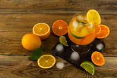 Jug of cool fruit cocktail on wooden table Royalty Free Stock Image