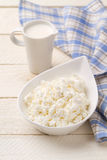 Jug of cream and cottage cheese Stock Images