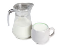 Jug and cup with milk Royalty Free Stock Photos