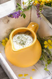 Jug of dill sauce Stock Photos