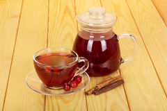 Jug with  drink, cup tea rosehip berries on  light wood. Stock Images