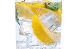 In the jug is a drink of ice, the lobules of a fresh juicy lemon and crystal clear water. In the jug is a drink of ice, the lobules of a fresh juicy yellow royalty free stock photography