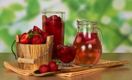 Jug with drink from strawberry Royalty Free Stock Image