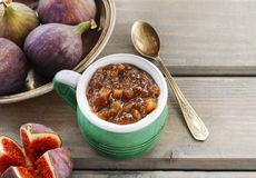 Jug of fig jam and bowl of fresh figs Stock Image