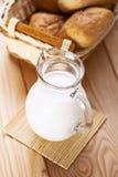 Jug of fresh milk and basket Royalty Free Stock Image
