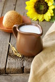 Jug of fresh milk and bread   rustic still life Royalty Free Stock Images